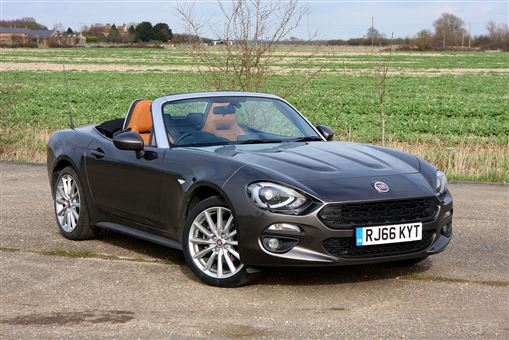 fiat 124 spider lusso plus 1 4 multiair turbo 140hp 2d road test parkers. Black Bedroom Furniture Sets. Home Design Ideas