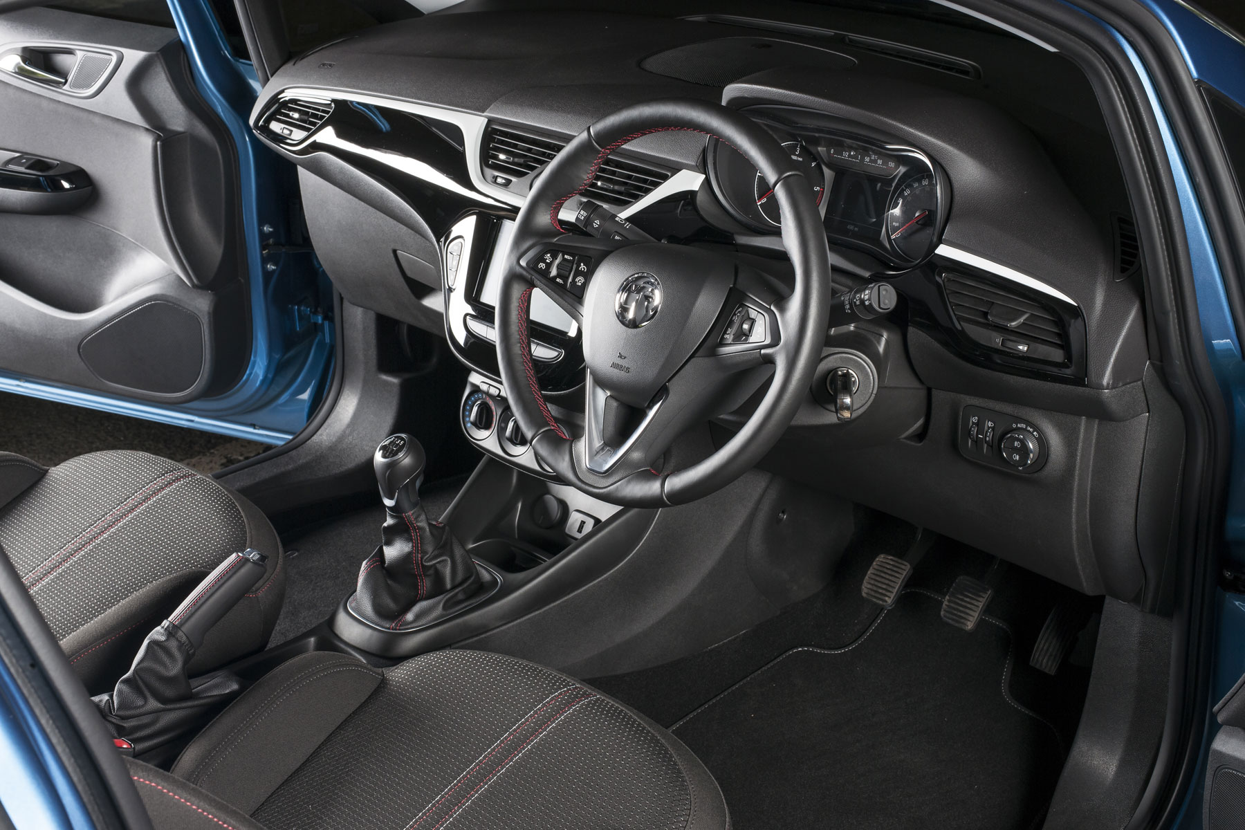 Vauxhall Corsavan Limited Edition Nav review - steering wheel and red stitching